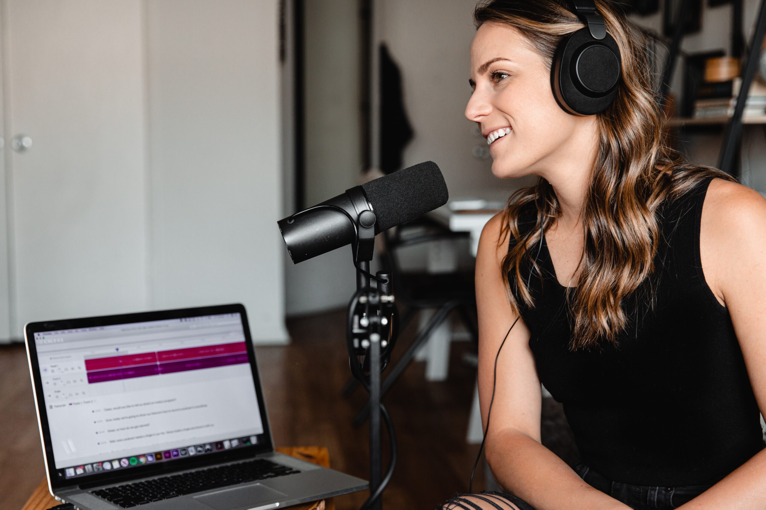woman recording podcast what podcast equipment do i need beginner